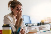 young female professional stressed at work