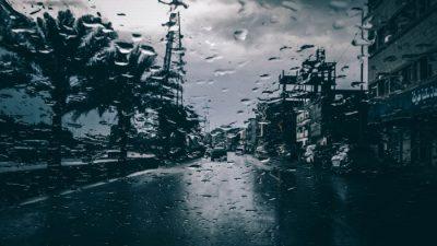 view through car windshield on stormy road and rain during texas hurricane season